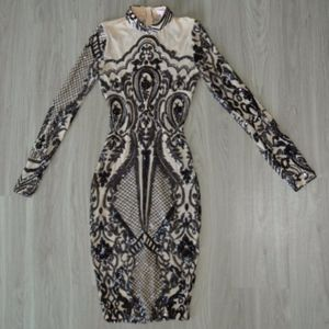 Nude and black midi dress